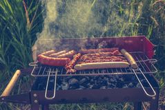 Grill. Fried meat on the grill Stock Photography