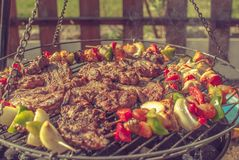 Grill. Fried meat on the grill Stock Image
