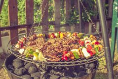 Grill. Fried meat on the grill Royalty Free Stock Photography