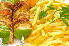 Grill and fries. Close up of grilled barbecue and fries Stock Photography