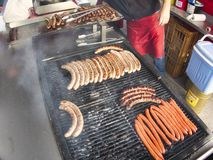 Grill frying fresh meat barbecue sausages, BBQ picnic sandwich store. Frying fresh meat barbecue sausages merguez brats, BBQ picnic sandwich store outdoor on big stock photos