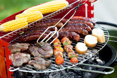 Grill full of delicious food Stock Images