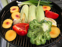A grill full of fresh fruit and vegetables Royalty Free Stock Photos