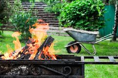 Grill mangal with burning. Grill with firewood in flame. Outdoor gathreing concept Stock Photos