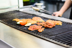 The grill master. Grilling on the charcoal grill Royalty Free Stock Images