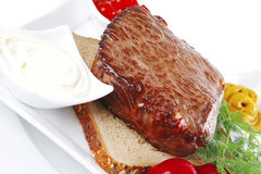 Grill meat on bread Stock Photography
