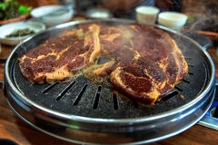 Grill meat on circle stanless pan Royalty Free Stock Photo