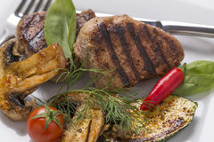 Grill meat, with fresh vegetables on plate decoarted Royalty Free Stock Images