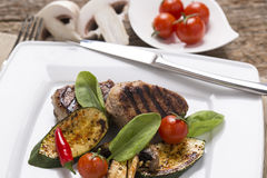 Grill meat, with fresh vegetables on plate decoarted Royalty Free Stock Photo