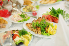 Grill Meat. On plate with salad and lemon Royalty Free Stock Images