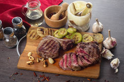 Grill meat rib eye steak composition on wooden background Royalty Free Stock Photo