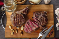 Grill meat rib eye steak composition on wooden background Stock Photo