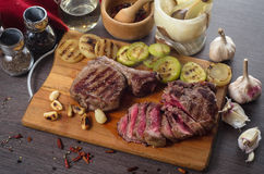 Grill meat rib eye steak composition on wooden background Stock Photos