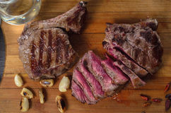 Grill meat rib eye steak composition on wooden background Royalty Free Stock Photography