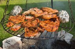 On the grill. Meat and Sausages on the grill Royalty Free Stock Image