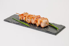 Grill meat on a wooden skewer with green onions on a white backg Stock Photos