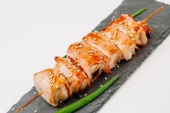 Grill meat on a wooden skewer with green onions on a white backg Stock Photo