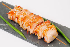 Grill meat on a wooden skewer with green onions on a white backg Royalty Free Stock Photos
