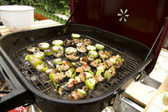 Grill menu. Cooking on the grill- fresh vegetables and meat Stock Photos