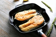 Grill pan with delicious salmon steaks Royalty Free Stock Photo