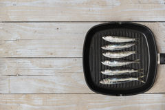 Grill pan with fish Stock Images