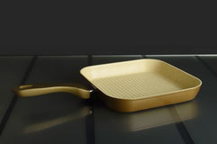 Grill pan on the glass substrate. In the kitchen Stock Photo
