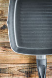 Grill pan on wood Stock Image
