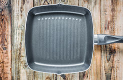 Grill pan on wood Royalty Free Stock Images