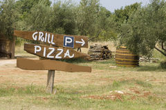 Grill parking. Grill, pizza and parking sign for nature texture background Stock Images