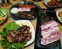 Grill pork slice on the hot BBQ pan, family dinner time, Korea food, yakiniku, Korea town. Grill pork slice on the hot BBQ pan, family dinner time, Korea food Stock Images