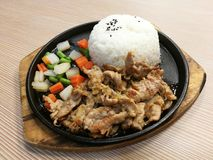 Grill pork slice on the hot BBQ pan with vegetable serve with rice, stir fried pork with garlice, lunch set meal, ready to eat, qu. Ick meal, Thai food, focus-on Stock Photos