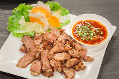 Grill pork with spicy sauce. Stock Photography