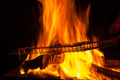 Grill rack on fire Royalty Free Stock Images