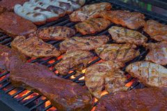 Grill rack full of meat for a delicious barbecue royalty free stock photos