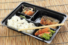 Grill Saba fish with steam rice in set bo Stock Image