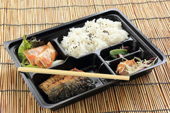 Grill Saba fish with steam rice in set box Stock Photo