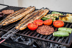 Grill. Salmon, meat and vegetables grill Stock Photography