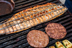 Grill. Salmon, meat and vegetables grill Royalty Free Stock Photography