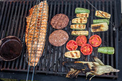 Grill. Salmon, meat and vegetables grill Royalty Free Stock Images