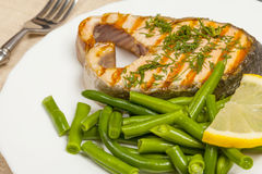 Grill the salmon on the plate Royalty Free Stock Image
