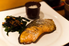 Grill salmon with seaweed Japanese food on white plate Stock Image