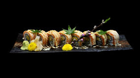 Grill Salmon sushi maki roll with Spicy cream sauce. Japanese sushi fish roll. Japanese tradition fus Stock Images