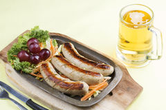 Grill Sausage with glass of Beer Stock Photos