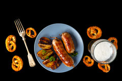 Grill sausages on a black background stock photo