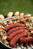 Grill sausages and chicken shashliks Royalty Free Stock Photos