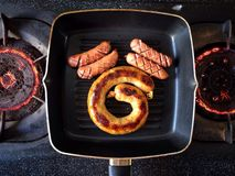 Grill sausages. Traditional Sausage of Thai Northern style on a hot pan, good smell and good taste Stock Photos