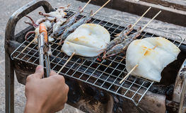 Grill seafood. On stove Royalty Free Stock Photo