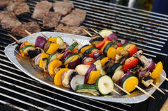 Grill shish and steaks. Photograph of fresh shishes and steaks on grill Royalty Free Stock Photos