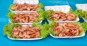 Grill of the shrimp . Grill of the shrimp with vegetables on disk Royalty Free Stock Photo