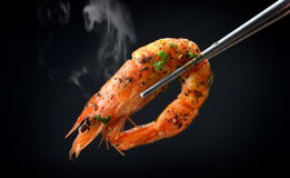 Grill Shrimp BBQ style. Mixed spicy ,ingredient set in black backgrount with smoke in studio lighting stock photography